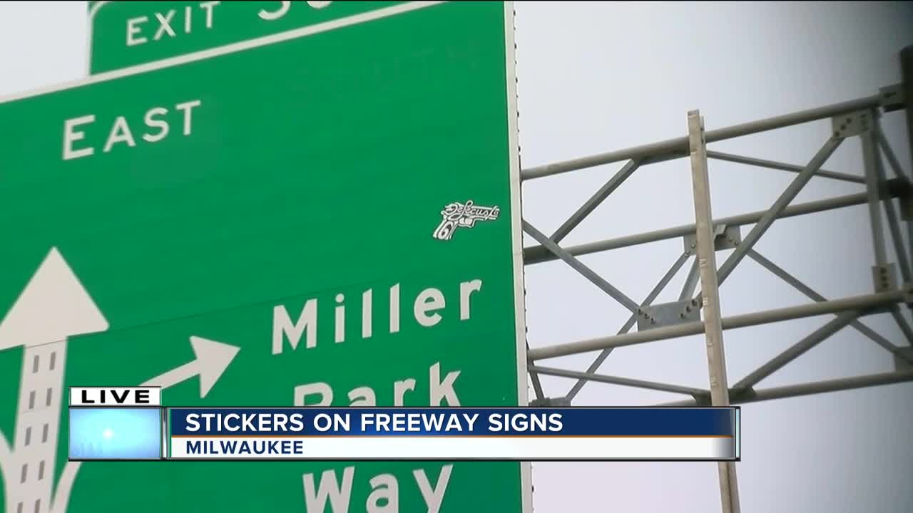 The milwaukee county highway department spent wednesday peeling off stickers from highway signs on i 94
